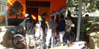 Guides participating in bike mechanic training by  Egidio Da Purificacao Soares