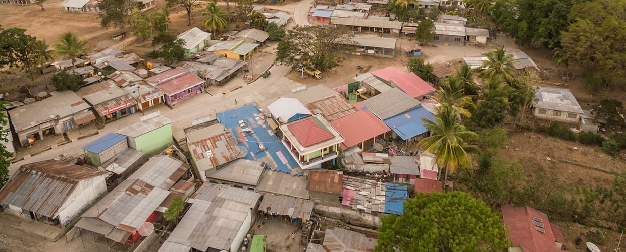 Timor-Leste: Transportation, Vehicle, Flagstone, Arecaceae, Flora, Palm Tree, Plant, Tree, Jar, Potted Plant, Pottery, Vase, Patio, Port, Waterfront, Building, City, Town, Urban, Aerial View, Landscape, Nature, Outdoors, Scenery, Neighborhood, Countryside, Rural, Lumber, Wood, Architecture, Downtown, Plaza, Town Square, Vegetation, Road, Street, Housing, Roof, Dock, Pier, Soil, Convention Center