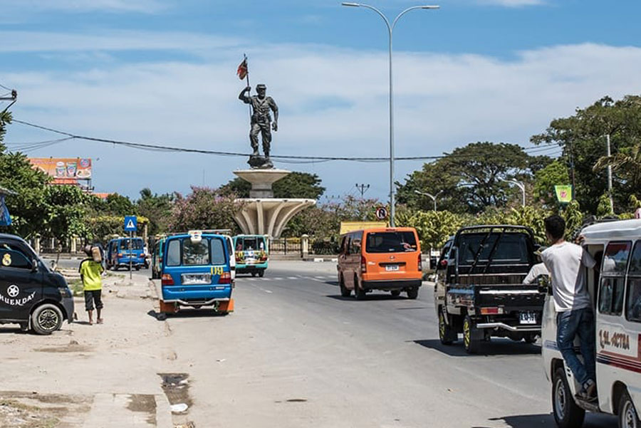 Timor-Leste: Person, Human, Vehicle, Car, Automobile, Transportation, Truck, Road, Pickup Truck, Tarmac, Asphalt, Bumper, Freeway, Highway, Van, Bus
